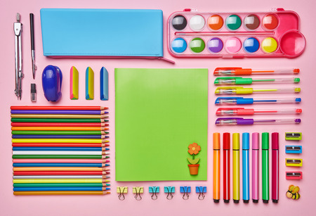 Desktop for the girl with her bright stationery Archivio Fotografico