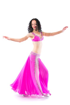 Wonderful brunette in the pink dress of an oriental dancer Stock Photo - 112102119