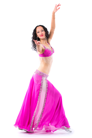 Sexy girl dancing belly dance. Isolated on a white background Stock Photo