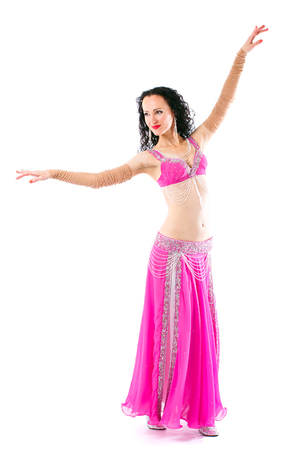 Wonderful brunette in the pink dress of an oriental dancer Stock Photo - 112102298