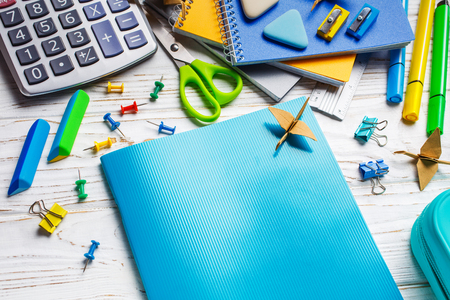 On a white table is a notebook. Back to school background Stock Photo