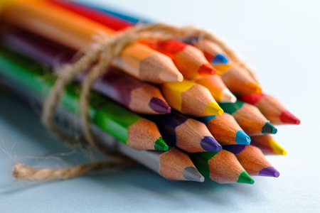 Bright color palette of crayons on the table Stock Photo