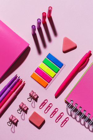 Bright stationery on a pink background. Flat lay, top view.