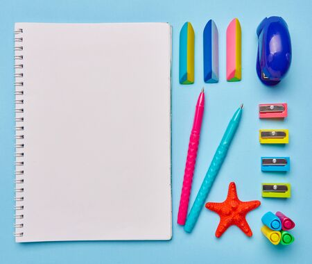 Group of school supplies lies on a light blue table. Stationery with copyspace. Concept of education or back to school. Top view, Flat lay. copyspace Zdjęcie Seryjne - 128957822