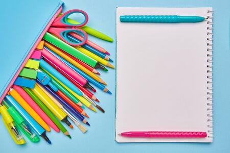 Bright composition from the stationery on a blue background Standard-Bild