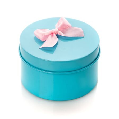 Turquoise surprise gift box with pink ribbon isolate Zdjęcie Seryjne