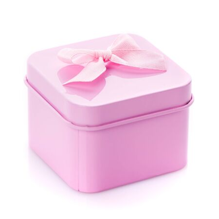 Pink gift box with pink bow on white background. Modern present for any holiday.