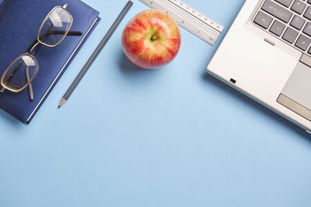 Desktop for student. After training, to recover strength - eat an apple. Flat lay. copyspace
