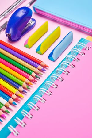 The composition is laid out from a color school stationery. School background. School and office supplies frame Zdjęcie Seryjne