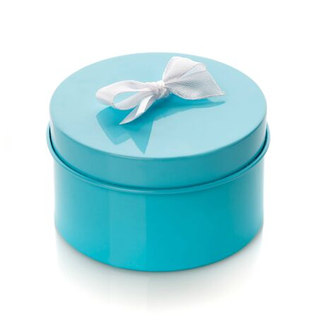 Turquoise gift box with white bow isolated on white. Side view