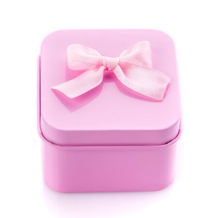 Single pink gift box with pink ribbon on white background. Top view
