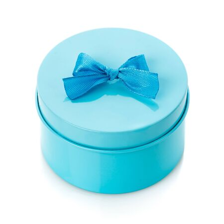 Single round turquoise gift box with blue bow on white background