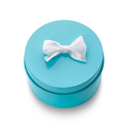 Turquoise gift box with white bow isolated on white. Top view. Clipping path included.