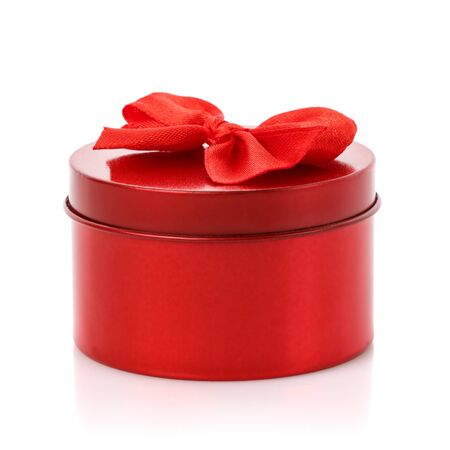 Single round red gift box with red bow on white background