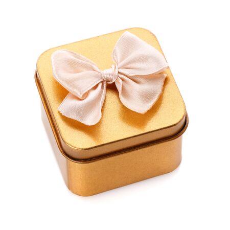 Gold gift box isolated on white background
