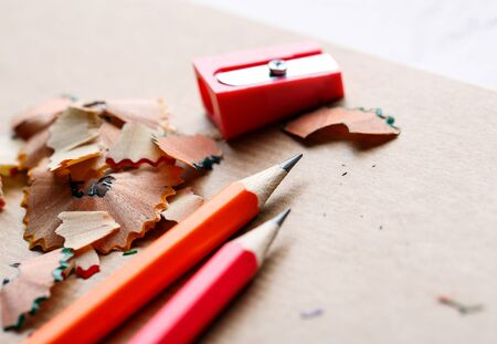 Sharpener, shavings and pencils on a white background. 1 September concept postcard, teachers day. Education concept