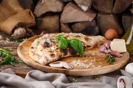 Pizza Calzone composed in half and baked. Mockup. Stock fotó - 133402896