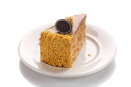 A piece of caramel cake, isolated on a white background Stock Photo