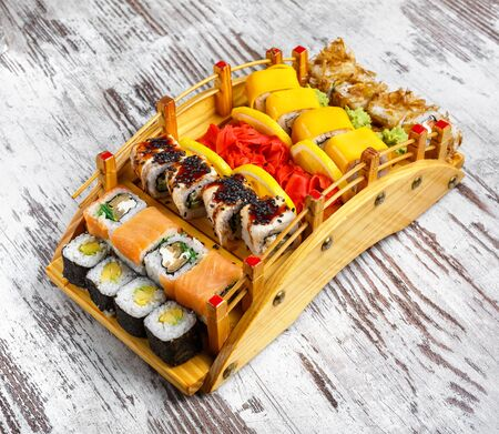 Sushi Set. Sushi rolls on wooden serving board Top view. Japan menu
