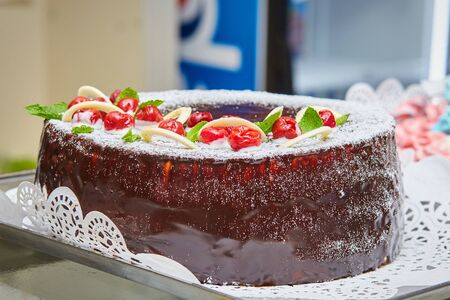 Tasty chocolate cake with cherries. Homemade baking. Holidays and dessert concept. Stock fotó