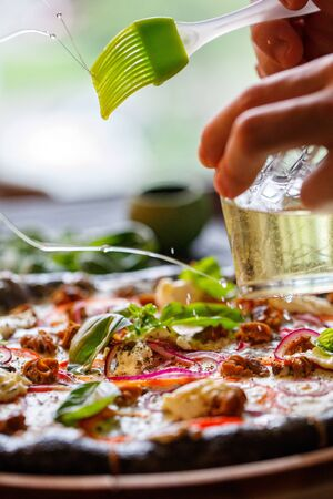 Olive oil is an integral ingredient of traditional Italian pizza. Cooking pizza. Stock fotó