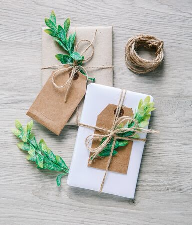 Natural style handcrafted gift boxes with rustic hemp cord. Kraft paper gift box with a label Stock fotó