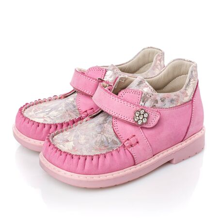 Childrens pink shoes for little girls on a white background. Photo for shoes advertisement. Side view Stock fotó
