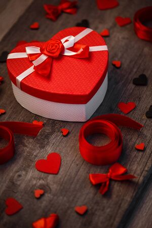 Love and holiday greeting concept background. Symbol of love. Red ribbon and heart decor. Love concept background.