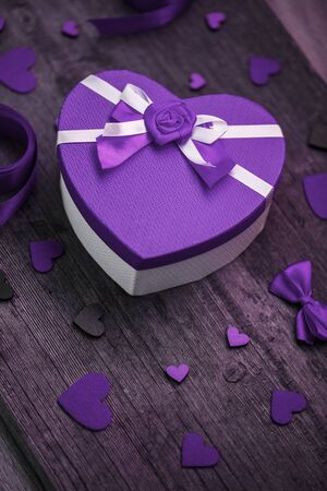 Purple box heart on a wooden background. Valentines day gift Stock fotó