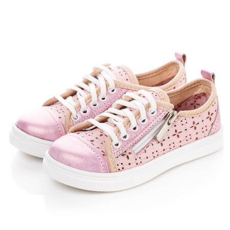 White with pink sneakers for girls on a white background. Photo for shoes advertisement. Side view
