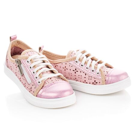 White with pink sneakers for girls on a white background. Photo for shoes advertisement