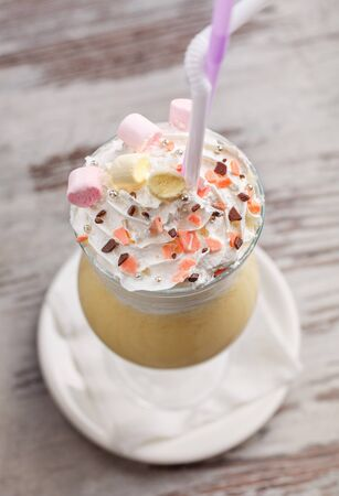 Delicious dessert. Ice cream in a glass with a rubbish and marshmallows. Dessert at the restaurant. Photo for restaurant advertising