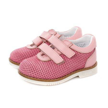 Children's pink shoes for girls on a white background. Photo for shoes advertisement. Side view Foto de archivo