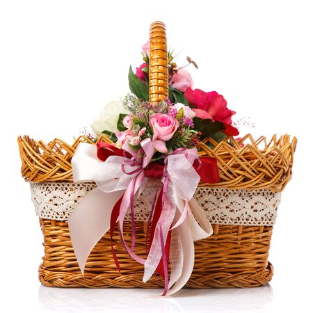 Very beautiful original brown wicker basket decorated with pink roses and pink ribbons. Close up