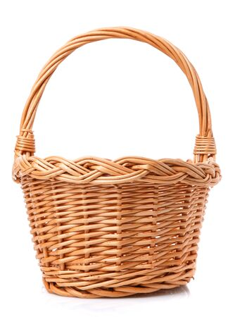 Big wicker basket on a white background. The basket is made of vines.