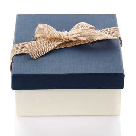 Cardboard box on a white background. Gift box with sacking ribbon. Surprise for the holidays.