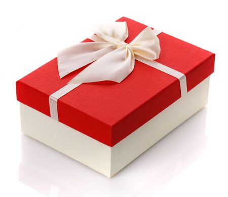 Gift box with big white bow. Isolated on white background. Surprise for the holidays.