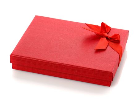 Elegant red gift box with a small bow. Isolated. Gift box for costume jewelry.