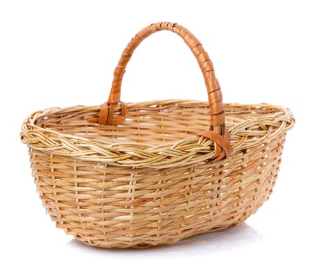 Oval brown wicker basket made of natural vine. Isolated. Handmade. Stock Photo
