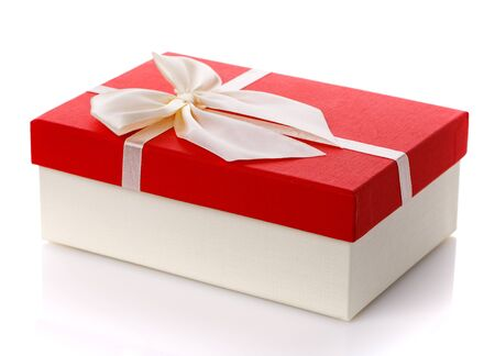 Red gift box with white ribbon bow isolated on white background. Side view. Gift for woman. Stock Photo