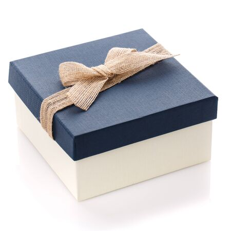 Blue gift box with beautiful burlap bow on a white background. Gift for man or woman. Side view.