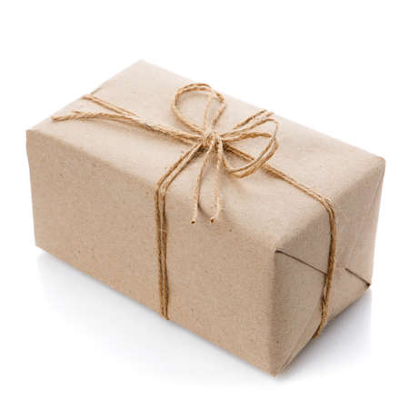 Box with gift wrapped in kraft paper on a white background.