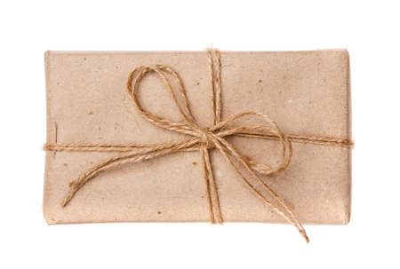 Wrapped vintage gift box with burlap ribbon. Isolated on white. Top view.
