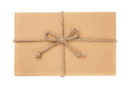 Brown vintage gift box with burlap ribbon bow. Isolated on white. Top view.