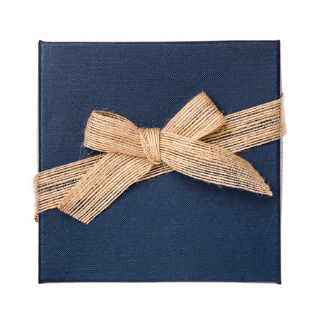 Dark blue gift box with burlap ribbon and bow on a white background. Top view.