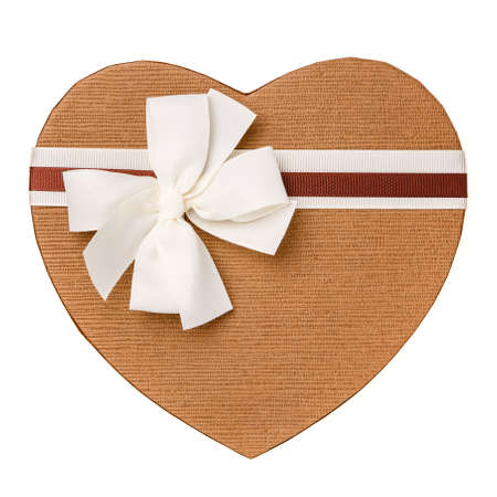 Brown gift box in the form of heart with white bow closeup on a white background. Top view. Congratulations on Women's Day, Mother's Day, Valentine's Day, Happy Birthday.