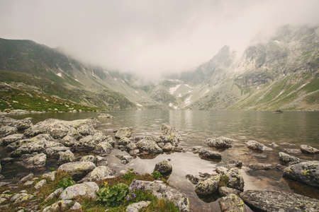 View of Lake Hincovo Pleso in High Tatras National Park. Slovakia. Fog over the lake. 스톡 콘텐츠 - 151620471