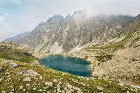 View from the top of the mountain to the big lake Hincovo pleso. High Tatras, Slovakia.