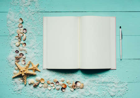 Summer background with notepad and seashells on wooden turquoise background. Holiday planning. Summer time, vacations, travel, tourism. Top view. Place for text. 스톡 콘텐츠 - 151620517