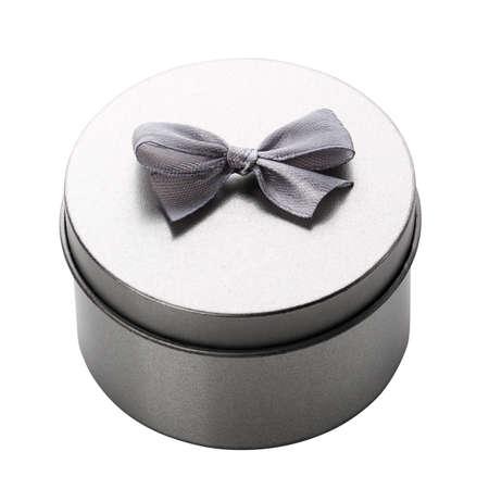 Round metallic silver gift box. on a white background.